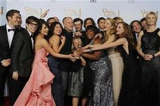 <p>Ryan Murphy (5th L), creator of the TV series 'Glee', and cast members pose with the award for best television comedy series at the 68th annual Golden Globe Awards in Beverly Hills, California, January 16, 2011. REUTERS/Lucy Nicholson</p>