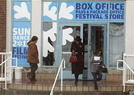 Ticket buyers exit a box office before the start of the Sundance Film Festival in Park City, Utah, January 19, 2011. REUTERS/Jim Urquhart