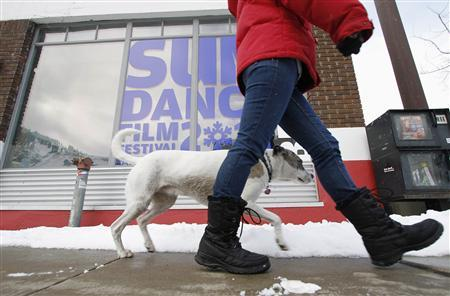 Sheila Harmon of Park City walks her dog Lola past the Kimball Art Center before the start of the Sundance Film Festival in Park City, Utah, January 19, 2011. REUTERS/Jim Urquhart