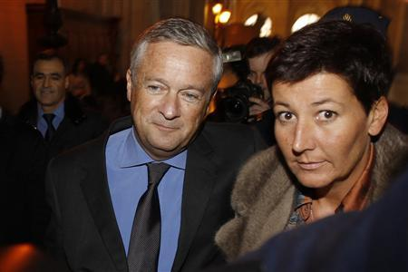 Former Vivendi head Jean-Marie Messier (L) and companion Christel Delaval arrive at the Paris courts for the verdict in his trial January 21, 2011. REUTERS/Benoit Tessier