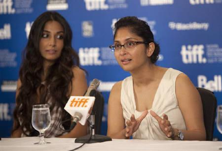 Actor Monica Dogra (L) and director Kiran Rao at a news conference to promote the film ''Dhobi Ghat'' during the 35th Toronto International Film Festival September 12, 2010. REUTERS/Fred Thornhill/Files