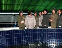 <p>North Korean leader Kim Jong-il (2nd L) visits the Taedonggang Eel Breeding Farm of the Korean People's Army (KPA) Unit 522 in this undated picture released by the North's official KCNA news agency in Pyongyang December 16, 2010. REUTERS/KCNA</p>