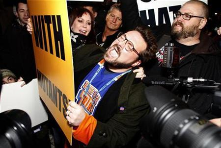 Director of the movie ''Red State'' Kevin Smith joins the counter-protest as members of the Westboro Baptist church protest his film screening at the Sundance Film Festival in Park City, Utah January 23, 2011. REUTERS/Jim Urquhart