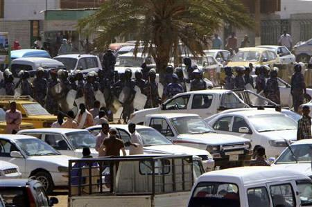 Heavily armed police patrol Khartoum's main streets January 30, 2011. Police beat and arrested students in central Khartoum, witnesses said on Sunday, as demonstrations broke out throughout the city demanding the government resign. REUTERS/Stringer