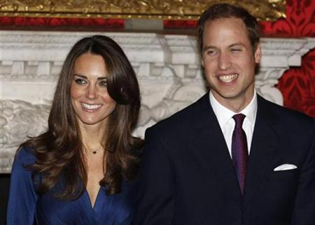 Britain's Prince William and his fiancee Kate Middleton (L) pose for a photograph in St. James's Palace, central London in a November 16, 2010 file photo. REUTERS/Suzanne Plunkett/files