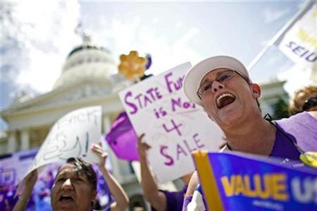 California state workers protest outside the State Capitol in Sacramento, July 1, 2009. REUTERS/Max Whittaker
