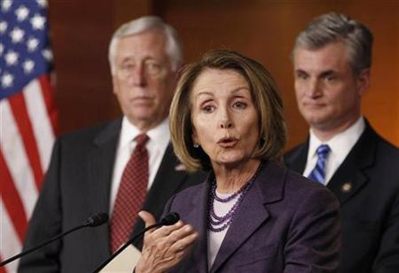Outgoing Speaker of the House Nancy Pelosi (C) speaks about the Republicans' campaign promise to roll back U.S. President Barack Obama's healthcare overhaul while next to outgoing House Majority Leader Steny Hoyer (L), and Rep. Robert Andrews (D-NJ), (R), during a news conference on Capitol Hill in Washington, January 4, 2011. REUTERS/Larry Downing