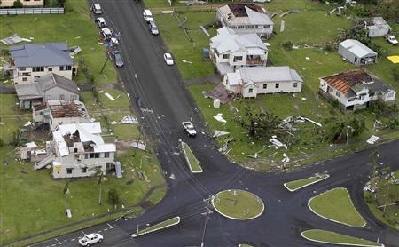 Houses with no roofs stand next to their undamaged neighbours after Cyclone Yasi passed the northern Australian town of Tully February 3, 2011. REUTERS/Tim Wimborne