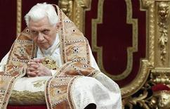 <p>Pope Benedict XVI kneels as he leads a vesper mass to mark the presentation of the Lord feast in Saint Peter's Basilica at the Vatican February 2, 2011. REUTERS/Max Rossi</p>