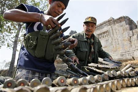 Cambodian soldiers load ammunition near Preah Vihear temple after a brief clash with Thai troops early February 5, 2011. REUTERS/Pheara