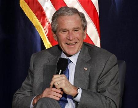 Former President George W. Bush laughs while answering questions about his presidency at the Ronald Reagan Presidential Library in Simi Valley, California, November 18, 2010. REUTERS/Lucy Nicholson