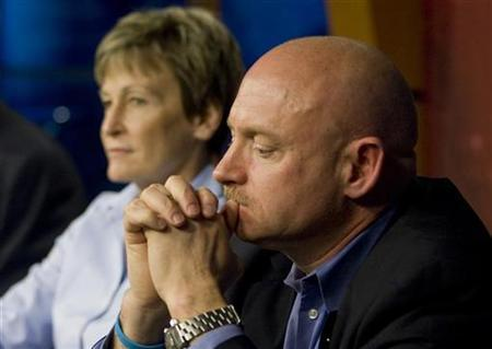 Astronaut Mark Kelly listens to questions with Peggy Whitson (L), chief of the NASA Astronaut Office at a news conference where it was announced that Kelly will serve as commander of the STS-134 space shuttle mission at the Johnson Space Center in Houston February 4, 2011. REUTERS/Richard Carson