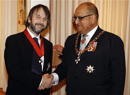 Director Peter Jackson (L) of New Zealand shakes hands with New Zealand's Governor-General Anand Satyanand after being knighted by Satyanand at Premier House in Wellington April 28, 2010. REUTERS/Dominion Post/ Kent Blechynden/Pool