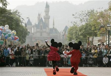 Mickey Mouse and Minnie Mouse characters greet visitors with their latest Year of the Mouse costumes at Hong Kong Disneyland in this January 21, 2008 file photo. REUTERS/Bobby Yip/Files