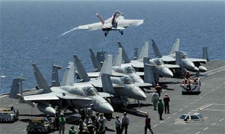 A U.S. Navy F/A-18F Super Hornet takes off from the USS George Washington for joint military exercises between the U.S. and South Korea in South Korea's East Sea, July 26, 2010. REUTERS/Lee Jin-man/Pool