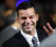 <p>Singer Ricky Martin waves from the audience at the Clinton Global Initiative in New York, September 24, 2009. REUTERS/Chip East</p>
