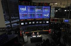 <p>London Stock Exchange CEO Xavier Rolet (L) and TMX Group CEO Tom Kloet speak to the media in an overall view of the TMX Broadcast centre regarding the merger of the TSX and the LSE in Toronto, February 9, 2011. REUTERS/Mark Blinch</p>