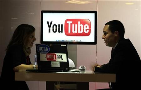 Visitors are seen at ''You Tube'' stand during the MIDEM, which is the international record music publishing and video music market, in Cannes January 23, 2011. REUTERS/Eric Gaillard