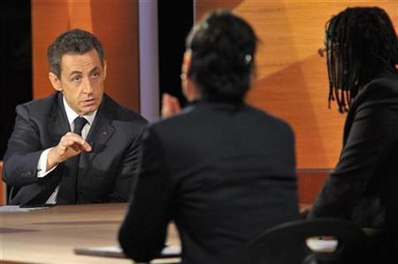 France's President Nicolas Sarkozy answers questions from some of nine citizens on jobs, security, care of the elderly and other domestic concerns in a live broadcast at French TF1 television studios in Paris February 10, 2011. REUTERS/Philippe Wojazer