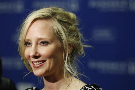 Cast member Anne Heche smiles as she arrives for the premiere of the film ''Cedar Rapids'' during the Sundance Film Festival in Park City, Utah January 23, 2011. REUTERS/Lucas Jackson
