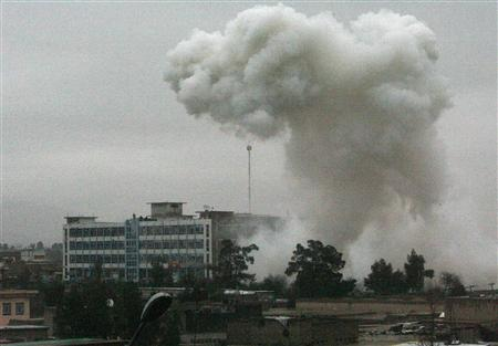 Dust and smoke rise after an explosion in Kandahar city February 12, 2011. REUTERS/Ahmad Nadeem