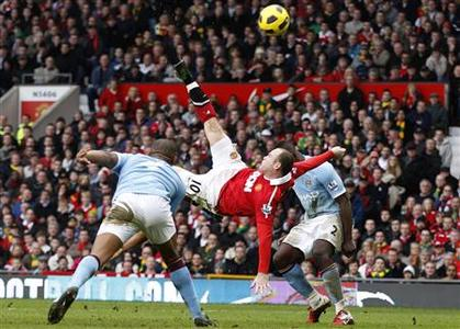 Manchester United's Wayne Rooney scores against Manchester City from an overhead kick during their English Premier League soccer match at Old Trafford in Manchester, northern England, February 12, 2011. REUTERS/Darren Staples