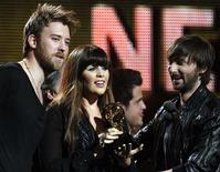 "<p>Charles Kelley (L), Hillary Scott (C) and Dave Hayward of Lady Antebellum accept the Grammy for Best Country Album for ""Need to Know"" at the 53rd annual Grammy Awards in Los Angeles, California, February 13, 2011. REUTERS/Lucy Nicholson</p>"