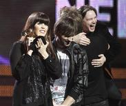 "<p>Lady Antebellum's Hillary Scott (L) and Dave Haywood accept the award for Song Of The Year for ""Need You Now"", as Charles Kelley hugs songwriter Josh Kear (R), at the 53rd annual Grammy Awards in Los Angeles, California February 13, 2011. REUTERS/Lucy Nicholson</p>"
