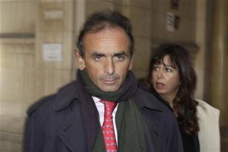 French journalist Eric Zemmour arrives for his trial at the Paris courts January 11, 2011. Zemmour is charged for racial libel by SOS anti-racism group for remarks he made on a Canal+ television talk show March 6 2010, ''Salut les Terriens'', about the greater surveillance by police of French immigrants than regular citizens. REUTERS/Jacky Naegelen