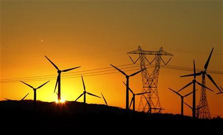 The sun rises behind windmills at a wind farm in Palm Springs, California, February 9, 2011. REUTERS/Lucy Nicholson