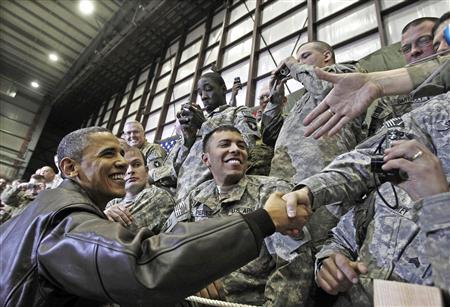 U.S. President Barack Obama meets with troops at Bagram Air Base, in this December 3, 2010 file photo. REUTERS/Jim Young