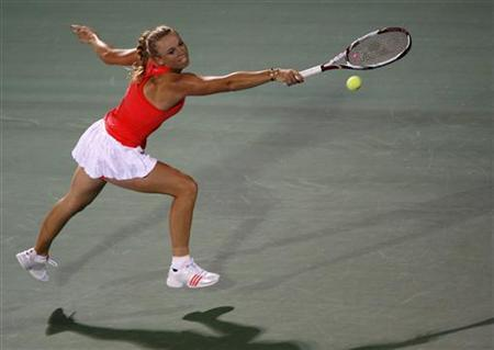 Caroline Wozniacki of Denmark hits a return to Anna Chakvetadze of Russia during their match at the WTA Dubai Tennis Championships February 16, 2011. REUTERS/Jumana El-Heloueh