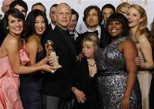 <p>Ryan Murphy (3rd L), creator of the TV series 'Glee', and cast members including Lea Michele (L) and others pose with the award for best television comedy series at the 68th annual Golden Globe Awards in Beverly Hills, California, January 16, 2011. REUTERS/Lucy Nicholson</p>