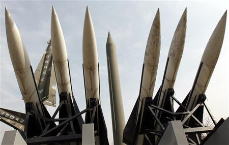 Models of a North Korean Scud-B missile (C) and South Korean Hawk surface-to-air missiles are seen at the Korean War Memorial Museum in Seoul February 17, 2011. REUTERS/Jo Yong-Hak