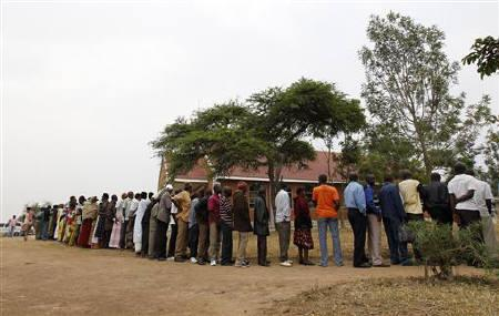 People queue to cast votes at a polling centre in Rushere, about 300 km west of Kampala, February 18, 2011. Ugandans voted in an election on Friday expected to extend President Museveni's time in power to three decades but which could turn nasty because the opposition wants street protests if the poll were deemed rigged. REUTERS/Thomas Mukoya