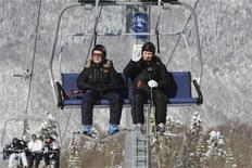 <p>Russian President Dmitry Medvedev (L) and Prime Minister Vladimir Putin share a ride on a chairlift during their visit to the Krasnaya Polyana resort near the southern Russia city of Sochi February 18, 2011. REUTERS/Alexsey Druginyn/RIA Novosti/Pool</p>