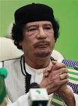 <p>Ливийский лидер Муаммар Каддафи выступает на открытии саммита ЕС-Африка в Триполи 29 ноября 2010 года. Ливийский лидер Муаммар Каддафи не собирается уходить в отставку, несмотря на массовые антиправительственные выступления в стране. REUTERS/Francois Lenoir</p>