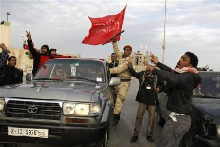 Protesters chant anti-government slogans in Tobruk February 22, 2011. Libyan soldiers in the eastern city of Tobruk told a Reuters correspondent on Tuesday they no longer backed Muammar Gaddafi and said the eastern region was out of the Libyan leader's control. REUTERS/Asmaa Waguih