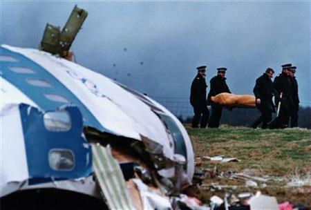 A file photo shows rescue personnel carrying a body away from the Lockerbie crash site in December 1988. REUTERS/Greg Bos