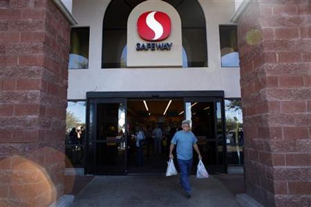 A man leaves a Safeway supermarket in Tucson, Arizona January 15, 2011. REUTERS/Eric Thayer