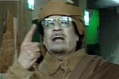 <p>Кадр из видеообращения Муаммара Каддафи в Триполи, 22 февраля 2011 года. Муаммар Каддафи скорее покончит жизнь самоубийством, как Адольф Гитлер в конце Второй мировой войны, чем сдастся или сбежит, сообщил шведской газете Expressen бывший член кабинета министров Ливии Мустафа Мохамед Абуд Аль- Джелейл. REUTERS/Libyan State</p>
