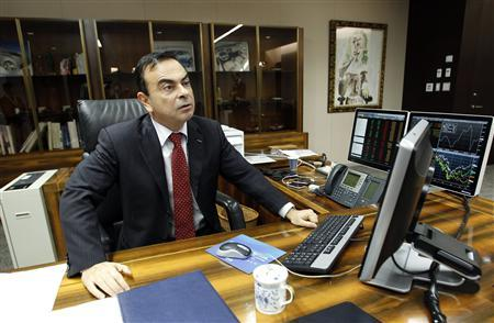 Carlos Ghosn, Chairman and CEO of Renault-Nissan Alliance, sits at his desk during a photo opportunity after an interview with Reuters at Nissan headquarters in Yokohama, south of Tokyo February 25, 2011. REUTERS/Yuriko Nakao