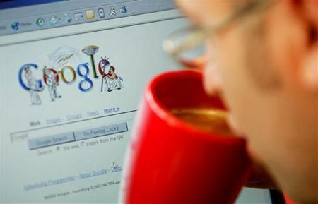 An internet surfer views the Google home page at a cafe in London in a file photo. REUTERS/Stephen Hird/Files