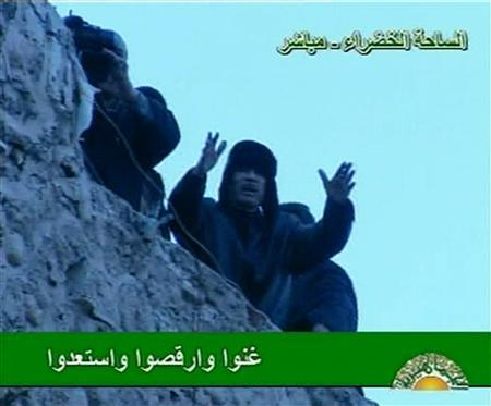 Libyan leader Muammar Gaddafi addresses his supporters in Tripoli's Green Square in this still image taken from video broadcast on February 25, 2011. REUTERS/Libya TV via Reuters TV