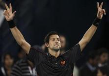 <p>Djokovic, da Sérvia, comemora após vitória na final contra Federer, da Suíça, em Dubai. 26/02/2011 REUTERS/Jumana El-Heloueh</p>