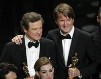 "<p>British actor Colin Firth (L), winner of the Oscar for best actor, and British director Tom Hooper, winner of the Oscar for best director, from ""The King's Speech"" stand with their Oscars during the closing of the telecast during the 83rd Academy Awards in Hollywood, California, February 27, 2011. REUTERS/Gary Hershorn</p>"