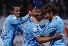 <p>Andre Ayew do Olympique Marseille (centro) comemora gol com Gabriel Heinze (dir) e Fabrice Abriel durante jogo contra o Nancy. 27/02/2011 REUTERS/Vincent Kessler</p>