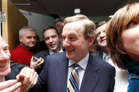 Fine Gael leader Enda Kenny is congratulated by supporters at the count centre in Castlebar, County Mayo, February 26, 2011. REUTERS/Cathal McNaughton