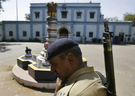 An Indian security personnel stands guard outside the Sabarmati central jail in the western Indian city of Ahmedabad February 25, 2011. REUTERS/Amit Dave