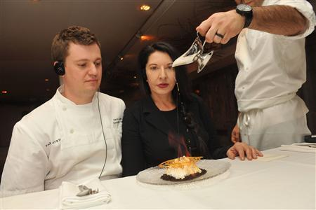 Artist Marina Abramovic presents the Volcano Flambe, a multisensory culinary intervention by the artist, in collaboration with Park Avenue Winter executive chef Kevin Lasko in New York, January 12, 2011. REUTERS/Diane Bondareff/Handout